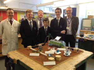 The completed model with left to right: Technology teacher Peter Robinson, Daniel Bell, Engineer David Heaton, Jamie Gilmore, Josh Bower and Engineer David Williamson.